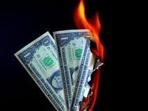 Dinheiro a queimar-se Fotografia de Stock Royalty Free