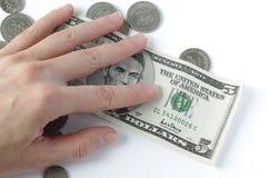 Dinheiro sob a mão imagens de stock