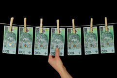 Dinheiro sujo que pendura de um clothesline isolado no preto Fotografia de Stock