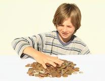 Dinheiro tocante do menino Foto de Stock