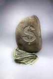 Dinheiro tornado mais pesado para baixo Fotografia de Stock Royalty Free