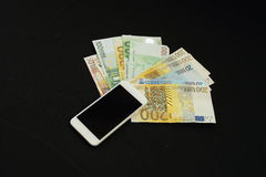 Dinheiro trocado em linha Imagens de Stock Royalty Free