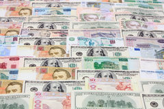 Dinheiro, várias moedas como um fundo Foto de Stock Royalty Free
