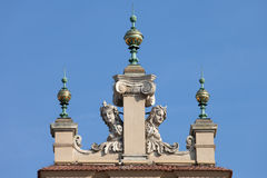 Dinials and Sculptures of the Sukiennice in Krakow Stock Images