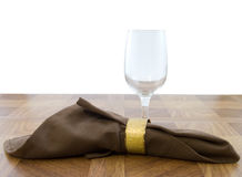 Dining. Glass and napkin on wooden table with white background Stock Photography