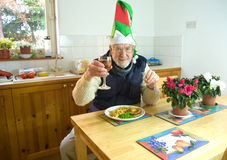 Dining alone at Christmas. Royalty Free Stock Images