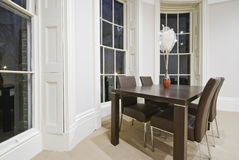 Dining area. With four seats in oval bay window royalty free stock images