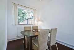Dining area. With oval wood table and knitted bamboo chairs royalty free stock images