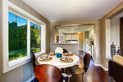 Dining area with big window and serving table set Stock Photos
