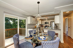 Dining area with blue chairs and table setting Stock Photos