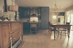 Dining area and country style kitchen of a home Royalty Free Stock Photos