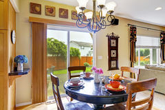 Dining area with exit to backyard patio Stock Photos