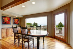Dining area with  exit to balcony and perfect water view Stock Image