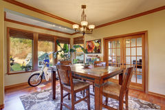 Dining area with hardwood floor. Wooden table set Stock Images