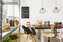 Dining area in industrial style. With table, chairs and regale Stock Photos