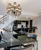 Dining area and kitchen. Dining table and chairs and kitchen with island unit Stock Photography