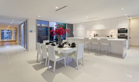 Dining area and kitchen Stock Images