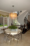 Dining area in a new house whit staircase. Royalty Free Stock Photography