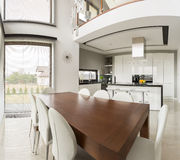 Dining area and open kitchen Royalty Free Stock Photography