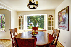 Dining area with round wooden table Stock Image