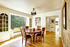 Dining area with round wooden table Royalty Free Stock Photo