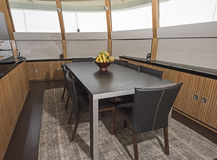 Dining area with table on luxury motor yacht Stock Image