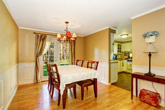 Dining area with table set and nice curtains. Stock Photography