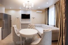 Dining area with TV and sofa - light, light interior stock image