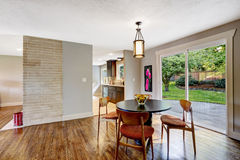 Dining area with walkout deck in new house Stock Photos