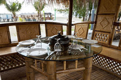 Dining in Bamboo Hut at Beach Side. Beach and Bamboo Hut at Morib, Malaysia Royalty Free Stock Images