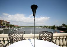 Dining on the Bay. A table overlooking a Bay Stock Images
