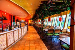 Dining cafe with wooden furnitures on cruise liner Stock Images