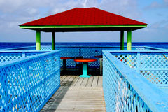 Dining on the caribbean. A small restaurant on the small island of cayman brac of the cayman islands provides a dining shelter over the ocean.  it is an Royalty Free Stock Photos