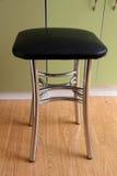 Dining chair with chrome legs Stock Photos