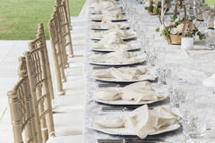 Dining Cutlery Chairs Tables Decor. Decor cutlery dining chairs tables outdoors tent celebration party outdoors at private home Royalty Free Stock Photos