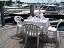 Dining on the dock. Table seating at the Marina Stock Photos