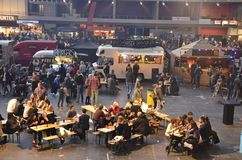 Dining at the Foodfestival in Amsterdam. Amsterdam, the Netherlands - November 29, 2015: Visitors at the Petit Amsterdam and the Cart Blanche food trucks in the Stock Photo