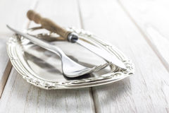 Dining fork and knife on rustic vintage background Stock Photos