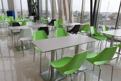Dining hall. Chairs and tables in a modern dining hall Royalty Free Stock Images
