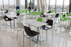 Dining hall. Chairs and tables in a modern dining hall Stock Photography