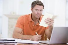 dining holding laptop man paperwork room στοκ εικόνα με δικαίωμα ελεύθερης χρήσης