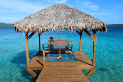 Dining on the Jetty. Dining on the glass bottom jetty in Vanuatu Stock Image
