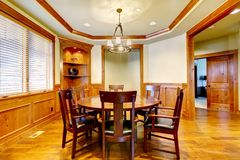 Dining luxury room with wood molding and floor. Stock Photography