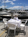 Dining at the Marina. Table setting on the dock Royalty Free Stock Photography