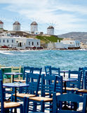Dining in Mykonos. At seaside. Behind the famous windmill of mykonos Stock Photos