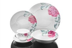 Dining porcelain set of plates and one cup with floral ornament on white background, product photography Stock Photos