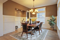 Dining Room. Large dining room with wood floors and area rug Stock Photo