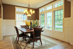 Dining Room. Large dining room with wood floors and area rug Stock Image