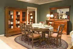 Dining room. Elegnat dining room with wooden furniture stock photography