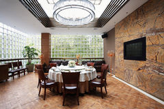 Dining room. Round table in Spacious Dining Room Royalty Free Stock Photos